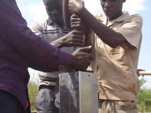 The Water Project : uganda6064-17-pump-installation