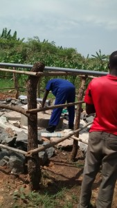 The Water Project : uganda6063-08-pump-installation