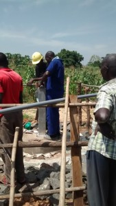 The Water Project : uganda6063-10-pump-installation