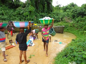 The Water Project : 2-sierraleone5097-alt-water-source-go-behind-wall