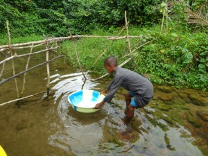The Water Project : 4-sierraleone5097-alt-water-source-fetching-water