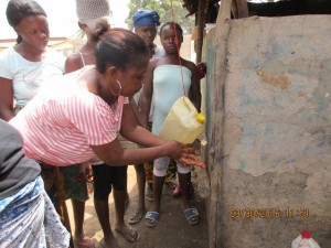 The Water Project : 27-sierraleone5079-using-a-tippy-tap