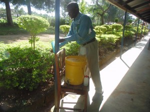 The Water Project : 8-kenya4617-teacher-hand-washing-station