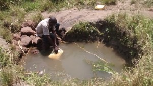 The Water Project : 2-uganda6077-water-hole