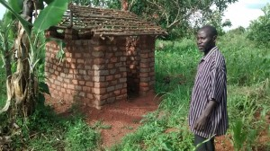 The Water Project : 4-uganda6066-well-caretakers-home