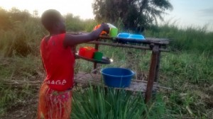 The Water Project : 10-uganda6074-using-a-dish-rack