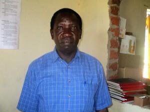 The Water Project : 12-kenya4643-principal-enos-kagali