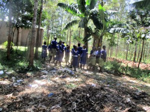 The Water Project : 14-kenya4642-pupils-throwing-garbage-on-school-farm