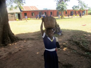 The Water Project : 2-kenya4642-pheobe-aunga-bring-maize-flour-to-school-for-lunch