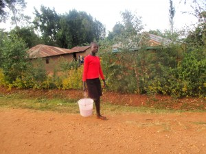 The Water Project : 20-kenya4643-rispa-takes-maize-to-grind-after-school