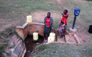 The Water Project : 4-kenya4643-josephine-and-angella-fetch-water-from-wandezwa-spring