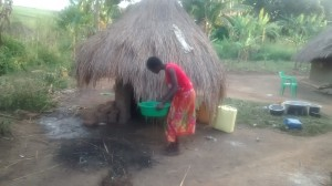 The Water Project : 6-uganda6074-cleaning-the-latrine