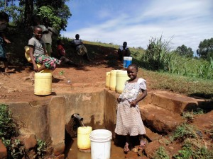 The Water Project : 8-kenya4636-community-girl-at-spring