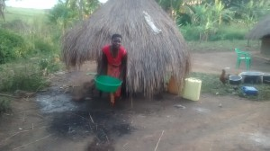 The Water Project : 8-uganda6074-cleaning-the-latrine