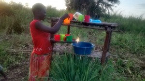The Water Project : 9-uganda6074-using-a-dish-rack