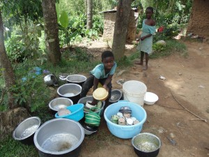 The Water Project : 14-kenya4701-child-washing-utensils