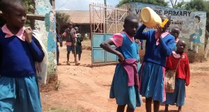 The Water Project : 2-kenya4648-pupil-drinking-from-jerrycan