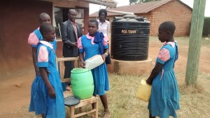 The Water Project : 20-kenya4648-refilling-hand-washing-station