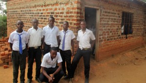 The Water Project : 5-kenya4645-students-pose-in-front-of-new-classrooms