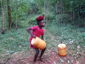 The Water Project : 5-kenya4703-trying-to-lift-full-jerrycan