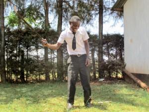 The Water Project : 8-kenya4633-student-slashing-grass
