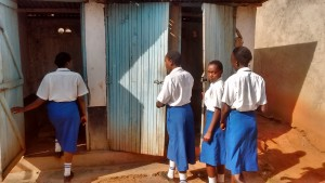 The Water Project : 14-kenya4650-showing-us-the-latrines