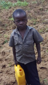 The Water Project : 4-kenya4700-ben-waiting-to-fetch-water
