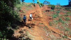 The Water Project : 6-kenya4708-climbing-the-slope-with-water