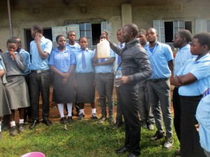 The Water Project : 1-kenya4643-trainer-erick-wagaka-demonstrating-water-treatment