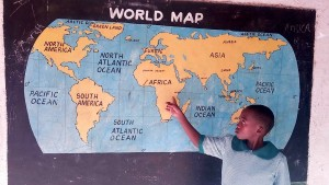 The Water Project : 1-kenya4661-pupil-shows-position-of-her-school-on-the-world-map
