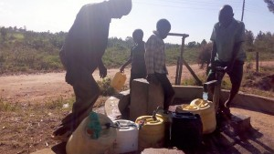 The Water Project : 10-kenya4661-community-using-the-nearby-well