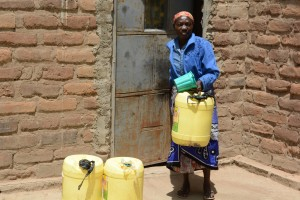 The Water Project : 12-kenya4782-family-one-fetching-water