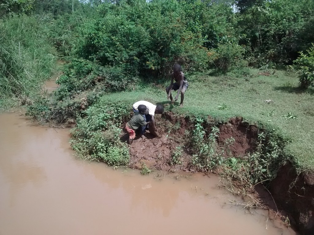13 kenya4710 children get local materials covered by the flooding waters
