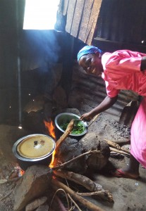 The Water Project : 13-kenya4828-mrs-leah-the-school-cook-prepares-a-meal-for-staff