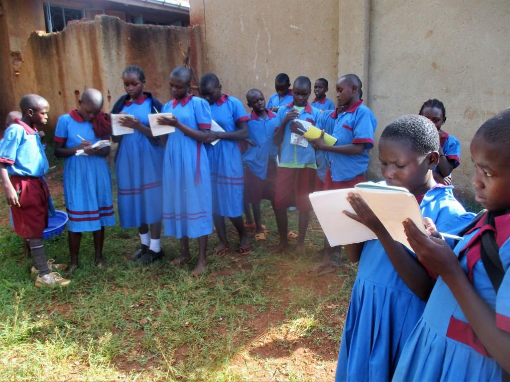 14 kenya4649 children taking notes on hand-washing