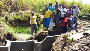 The Water Project : 14-kenya4700-artisan-explaining-the-spring-protection
