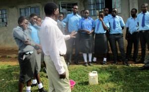 The Water Project : 16-kenya4643-principal-addressing-students