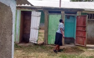 The Water Project : 16-kenya4661-teacher-showing-us-the-latrines