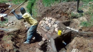 The Water Project : 18-kenya4704-artisan-digs-around-the-spring