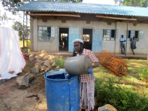 The Water Project : 19-kenya4643-parent-fetches-construction-water