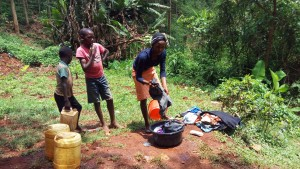 The Water Project : 2-kenya4708-woman-washing-her-clothes-during-training