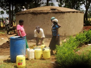 The Water Project : 20-kenya4643-collecting-construction-water