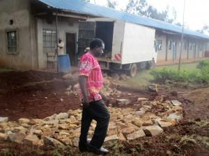 The Water Project : 22-kenya4643-headteacher-supervises-work