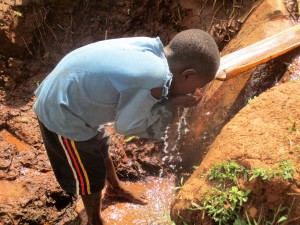 The Water Project : 3-kenya4715-quenching-his-thirst