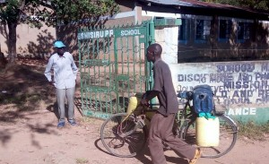 The Water Project : 9-kenya4661-community-member-coming-to-fetch-water