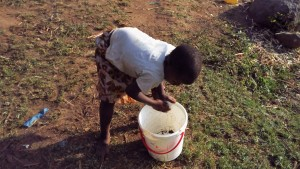 The Water Project : 1-kenya4743-cleaning-out-a-container