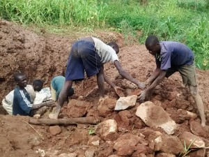 The Water Project : 16-kenya4715-community-members-clearing-the-area