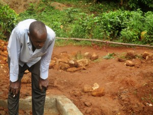 The Water Project : 17-kenya4706-community-member-watches-pipe-installation