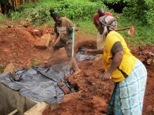 The Water Project : 18-kenya4706-community-members-help-backfill