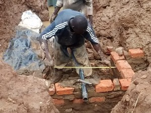 The Water Project : 19-kenya4715-building-the-wall